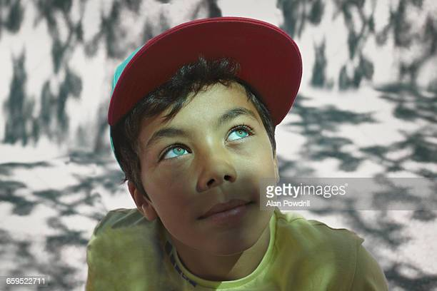 close up portrait of mixed race boy - mütze stock-fotos und bilder