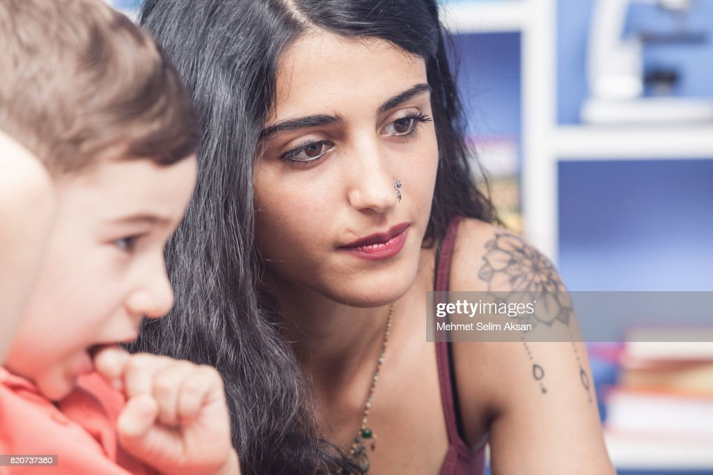 Close Up Portrait Of Mixed Race Young Nanny And Little Boy : Stock Photo