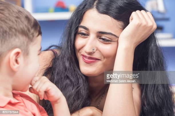 Close Up Portrait Of Mixed Race Young Nanny And Little Boy