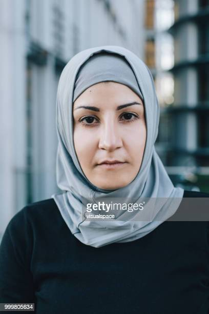 Close up portrait of muslim woman.