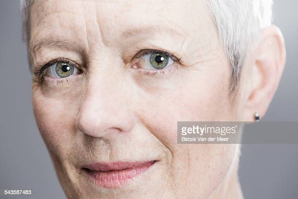 close up portrait of senior woman. - green eyes stock pictures, royalty-free photos & images