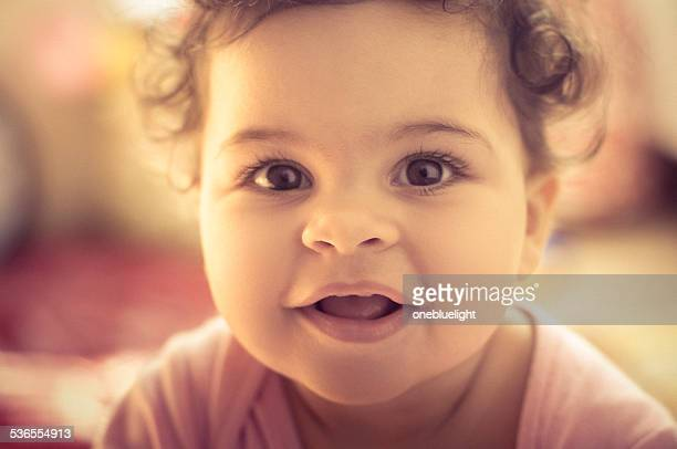 PEOPLE: Close Up Portrait Of Smiling Baby Girl.