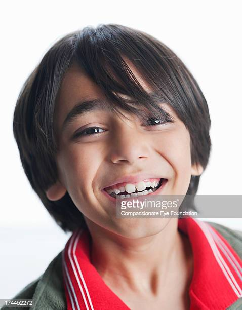 "close up portrait of smiling boy (8-9) - ""compassionate eye"" stock-fotos und bilder"