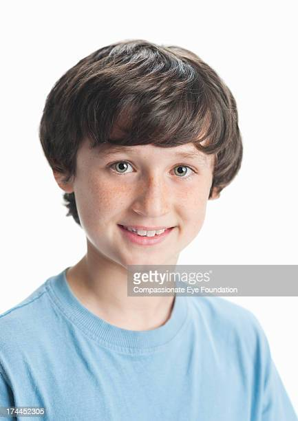 close up portrait of smiling boy (11-12) - grey eyes stock pictures, royalty-free photos & images