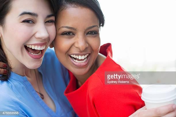 Close up portrait of smiling businesswomen