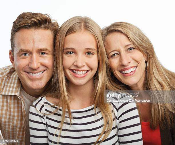 close up portrait of smiling family - femme entre deux hommes photos et images de collection