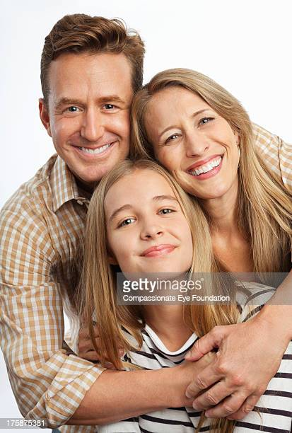 Close up portrait of smiling family