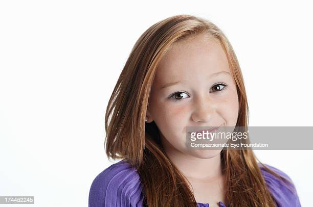 Close up portrait of smiling girl (11-12)