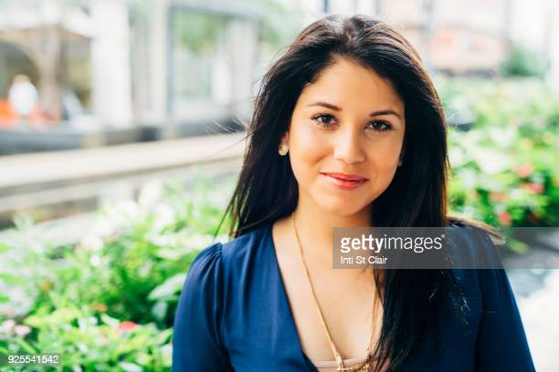 Close up portrait of smiling Hispanic woman