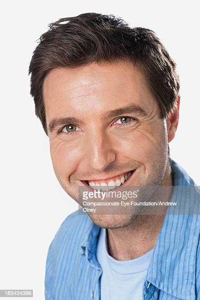 """close up portrait of smiling man - """"compassionate eye"""" imagens e fotografias de stock"""