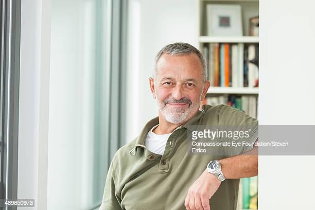 Close up portrait of smiling mature man indoors