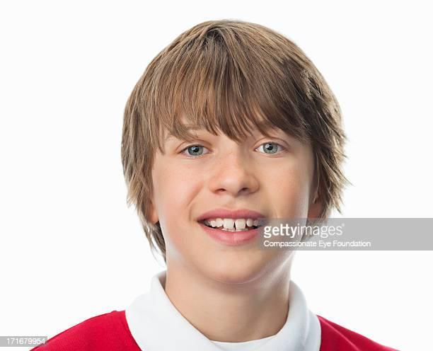 Close up portrait of smiling school boy (10-12)