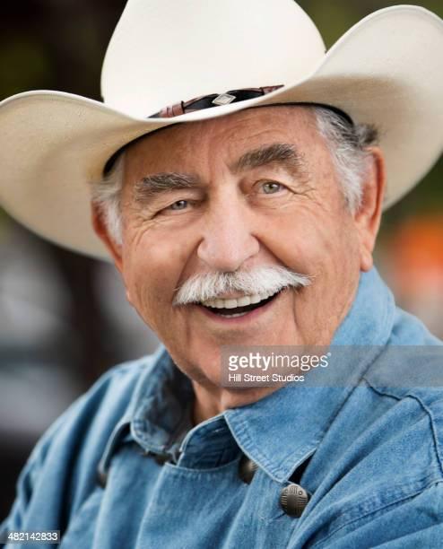 Close up portrait of smiling senior Caucasian man in cowboy hat