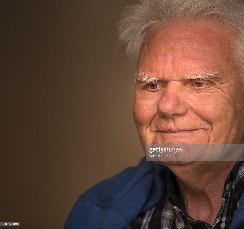 Close up portrait of smiling senior man : Foto stock