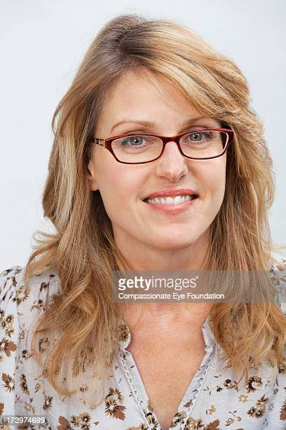 """close up portrait of smiling woman - """"compassionate eye"""" stock pictures, royalty-free photos & images"""
