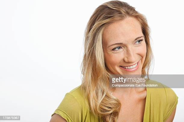 "close up portrait of smiling woman - ""compassionate eye"" stock-fotos und bilder"