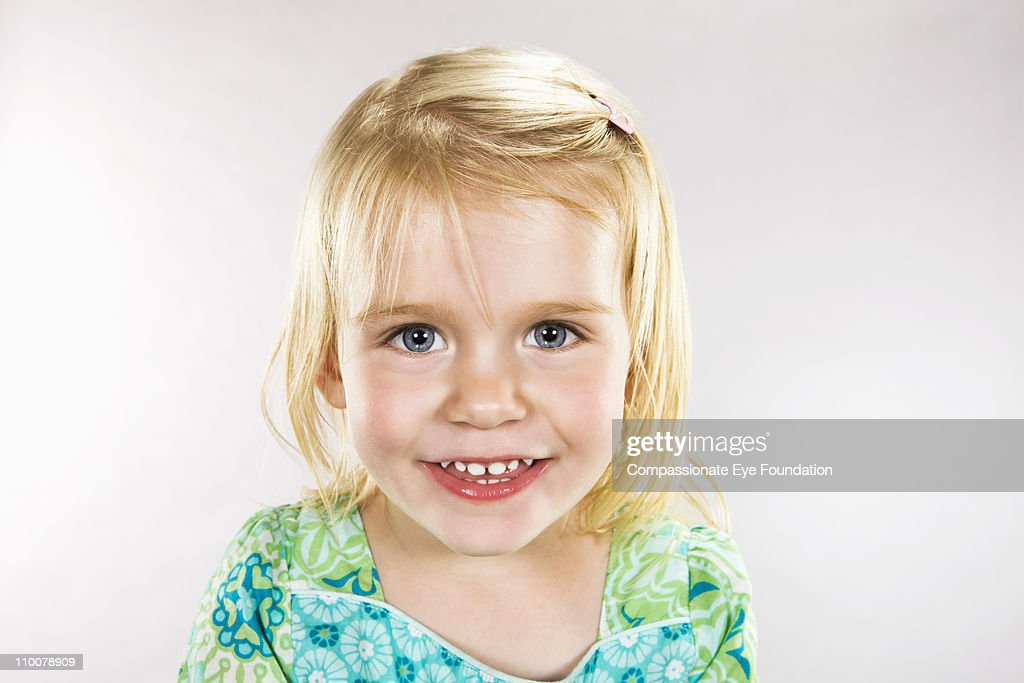 Close up portrait of smiling young girl : Stock Photo