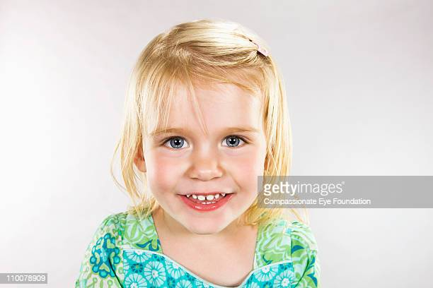 Close up portrait of smiling young girl