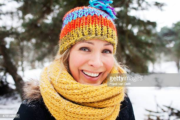 Close up portrait of woman in wooly hat and scarf in winter