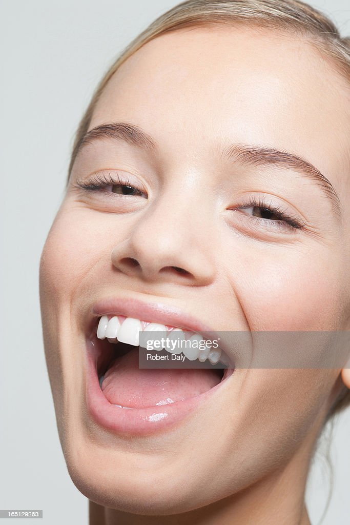 Close up portrait of woman laughing : Stock Photo