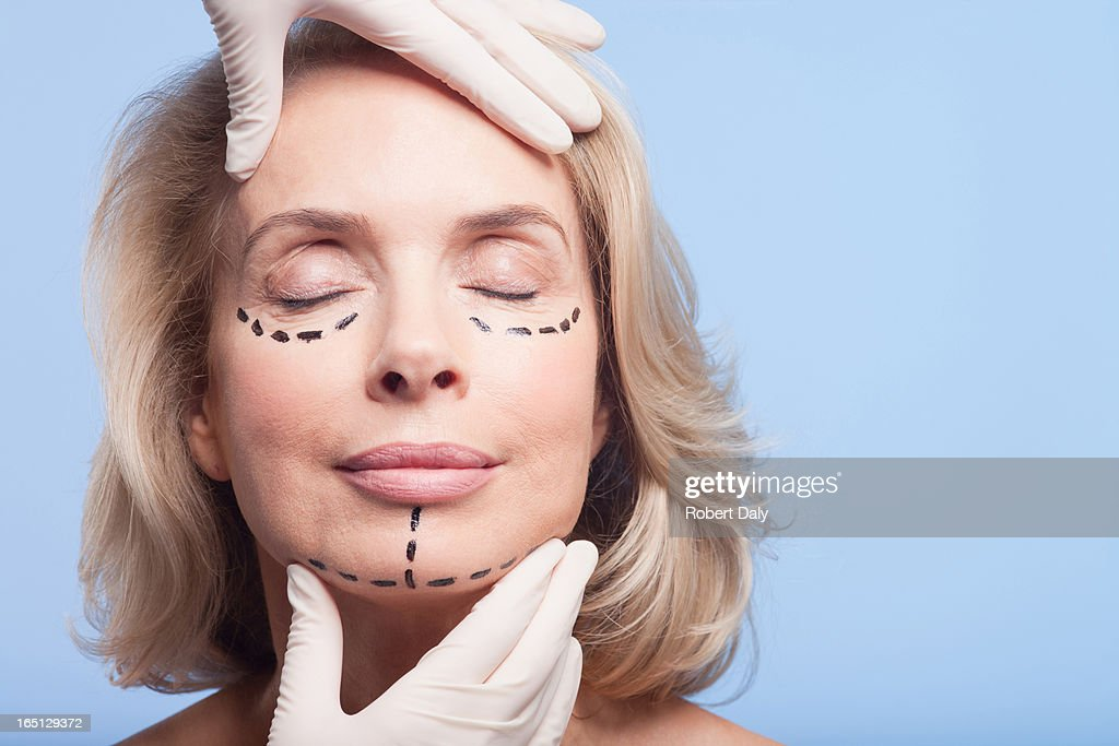 Close up portrait of woman with dotted lines on face : Stock Photo