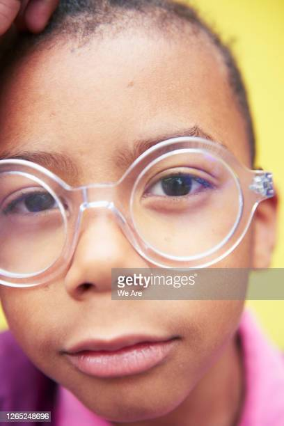 close up portrait of young boy in glasses - human head stock pictures, royalty-free photos & images