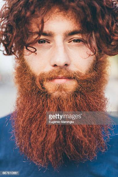 close up portrait of young male hipster with red hair and beard - beard stock pictures, royalty-free photos & images