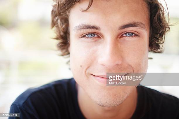 Close up portrait of young man with blue eyes