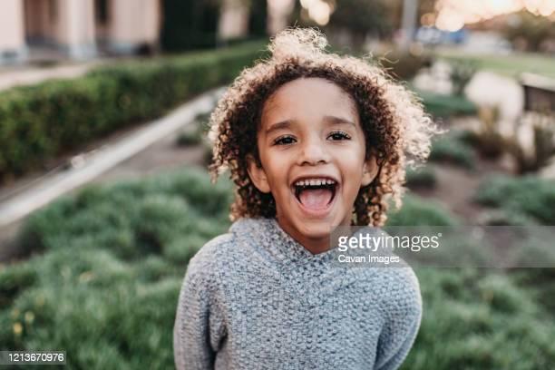 close up portrait of young school-aged confident boy smiling at - 4 5 anni foto e immagini stock