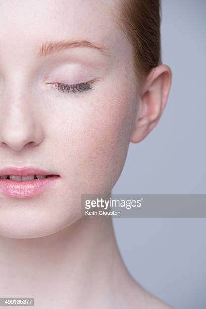 Close up portrait of young woman, eyes closed