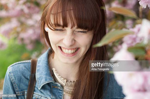 Close up portrait of young woman smiling with eyes closed