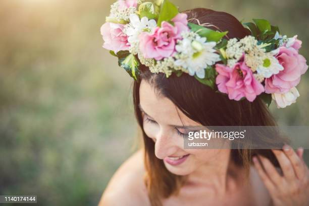 close up portrait of young woman with flowers wreath on head. - crown close up stock pictures, royalty-free photos & images