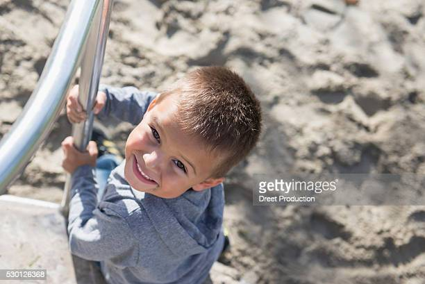 close up portrait small boy carousel playground - dreiviertelansicht stock pictures, royalty-free photos & images