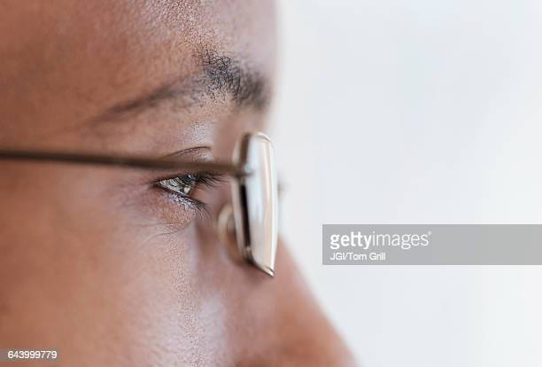 Close up profile of eyes and eyeglasses of Black man