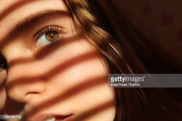 close up profile of young woman with shadows and interesting lighting - chichester stock pictures, royalty-free photos & images