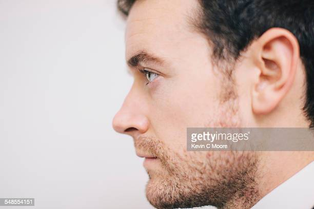 Close up profile portrait of young man staring ahead