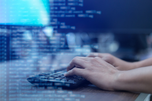 close up programmer man hand typing on keyboard at computer desktop for input coding language to software for fix bug and defect of system in operation room , technology concept 1142845130