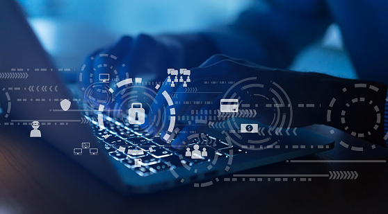 close up programmer man hand typing on keyboard laptop for register data system or access password with virtual interface of cyber security at dark operation room , concept 1057890202