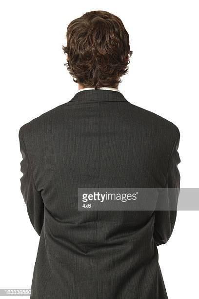 背面外観のクローズアップの絶縁ビジネスマン