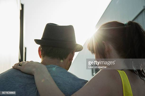 Close up rear view of young couple in street