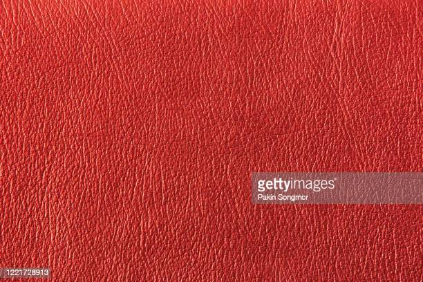 close up red leather and texture background. - red jacket stock pictures, royalty-free photos & images