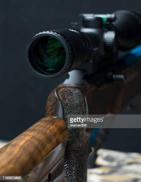 close up rifle gun barrel and wooden and dark black ground - ammunition magazine stock photos and pictures
