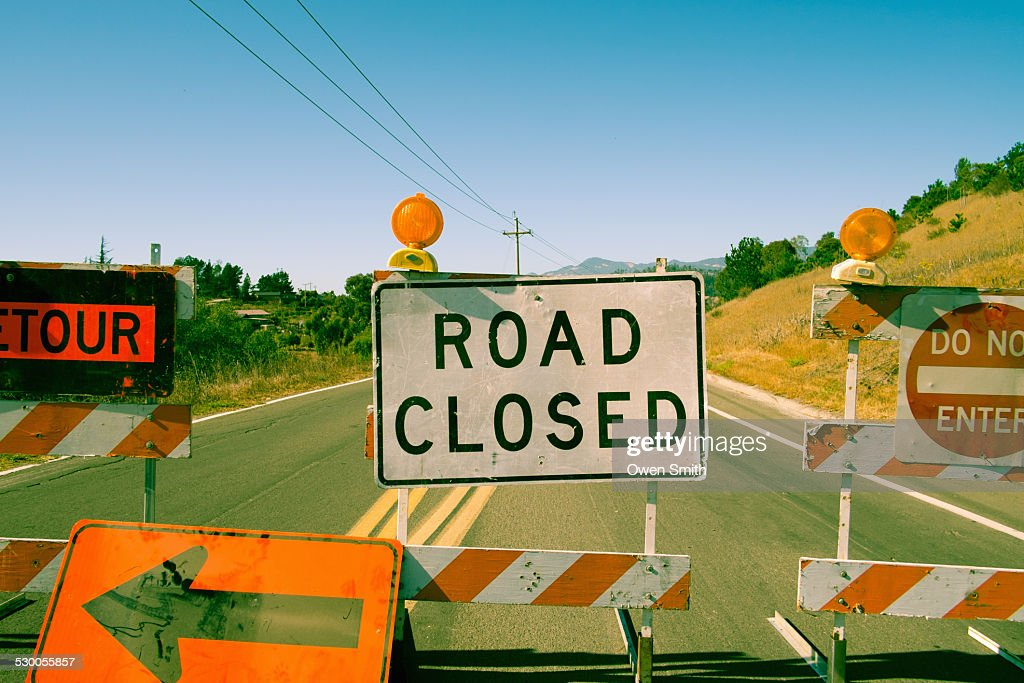 Close up row of road closed signs on highway : Stock Photo