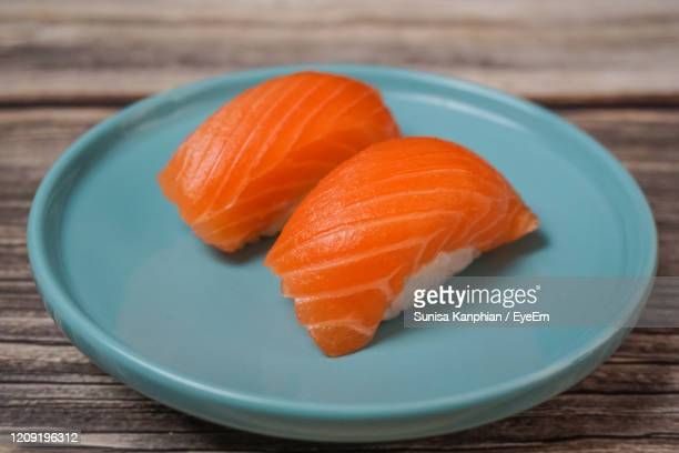 close up salmon sushi ,japanese food. - nigiri stock pictures, royalty-free photos & images