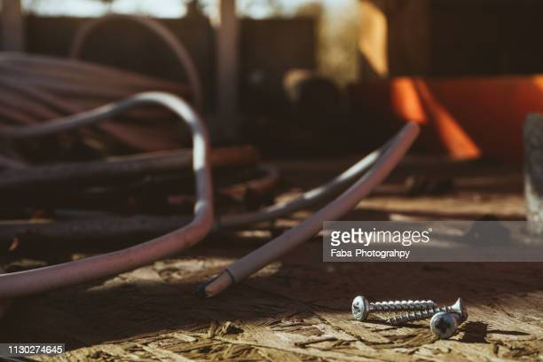 close up screws and building materials on construction site - berufliche beschäftigung stock pictures, royalty-free photos & images