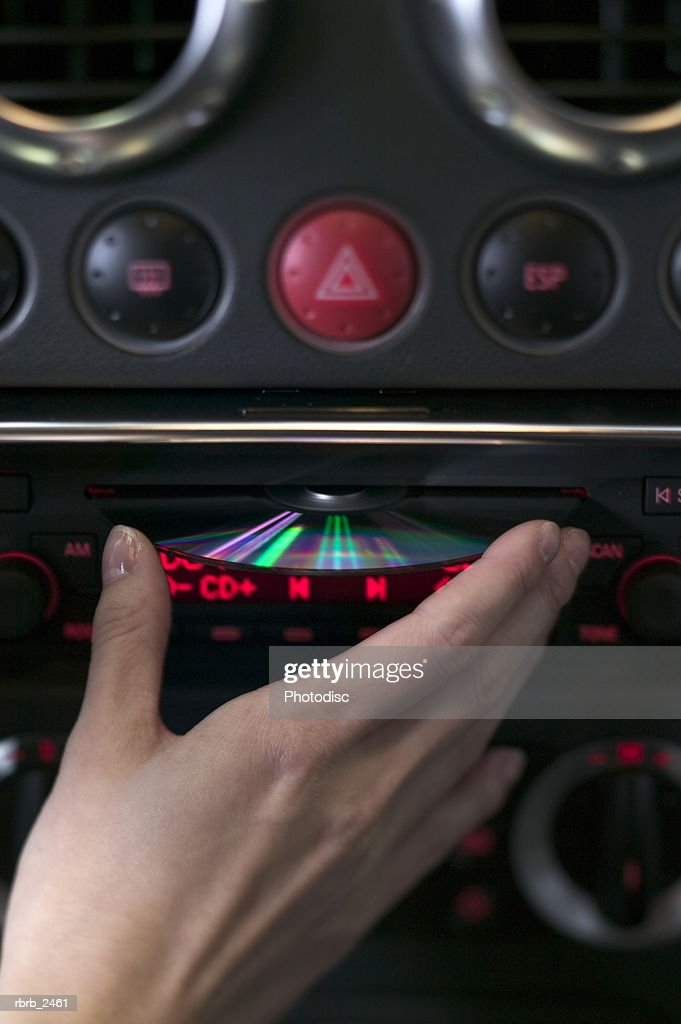 close up shot of a cd being put into a car stereo : Foto de stock