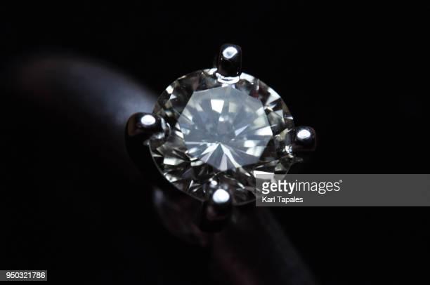 A close up shot of a diamond ring