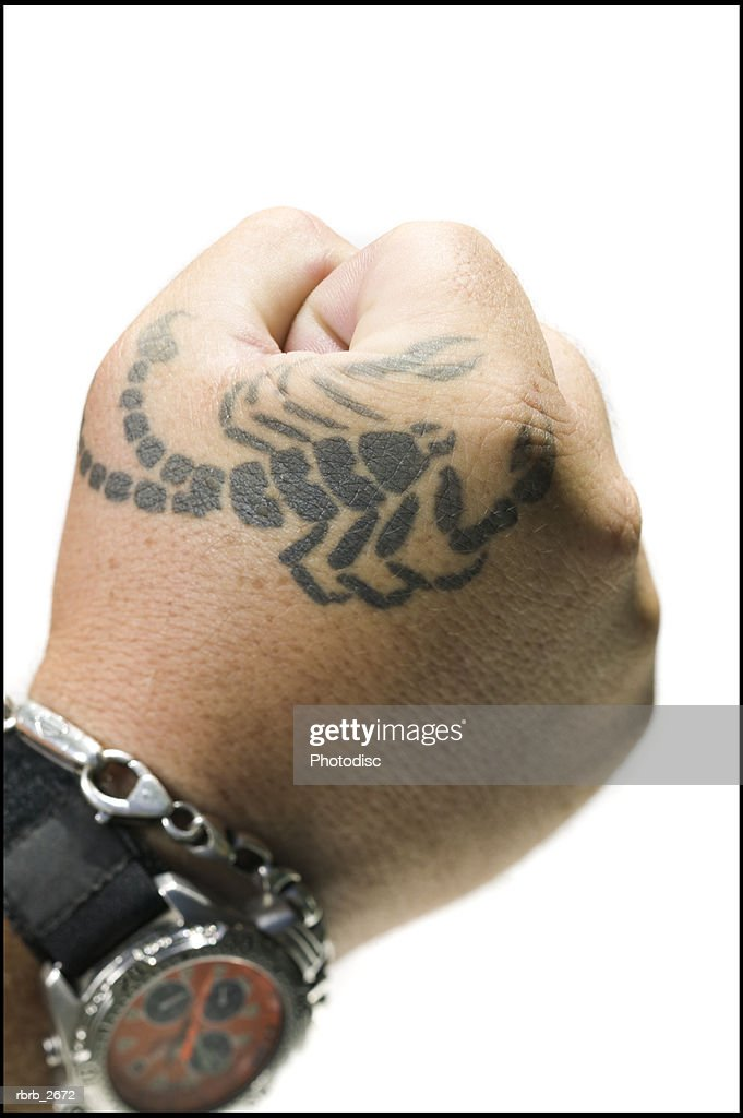 close up shot of a male fist with a tattoo : Foto de stock