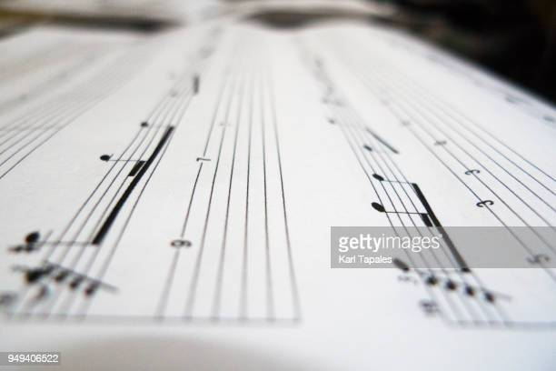 a close up shot of a musical sheet - chiave di violino foto e immagini stock