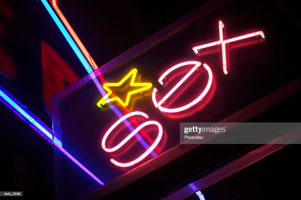 close up shot of a neon sign that says sex : Foto de stock